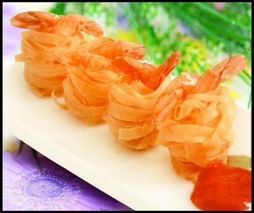 菜式:小吃 口味:咸鲜 烹饪方式:烘焙 场合:晚餐 菜谱介绍 千丝万缕虾